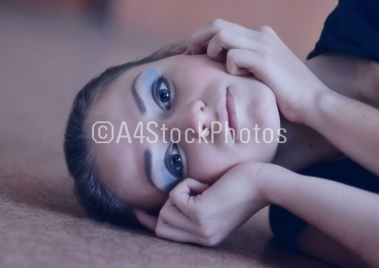 Fashionable,violet,nice,close-up portrait of young,calm,beautiful,glamour girl with blue,pretty,creative make-up,hands near the light,cute face,pure,clean,white skin.Serious girl with cute,fashionable
