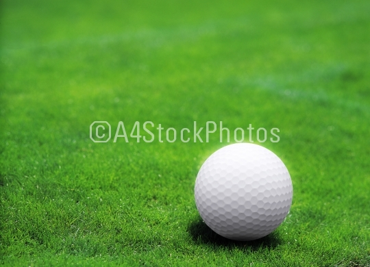 White golf ball on green